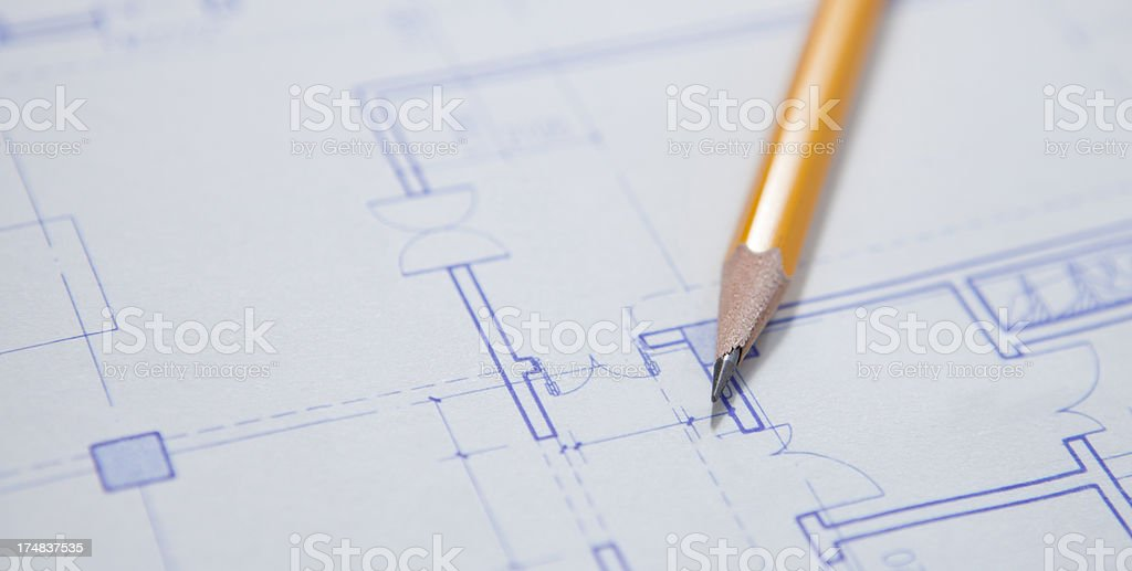 pencil on blueprints royalty-free stock photo