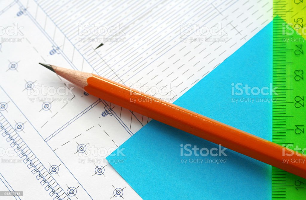 Pencil on the engineering drawings royalty-free stock photo