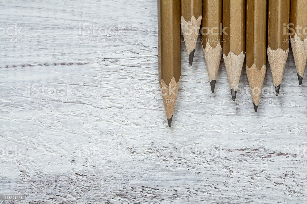 Pencil on wooden background stock photo