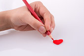 Pencil pointing a heart