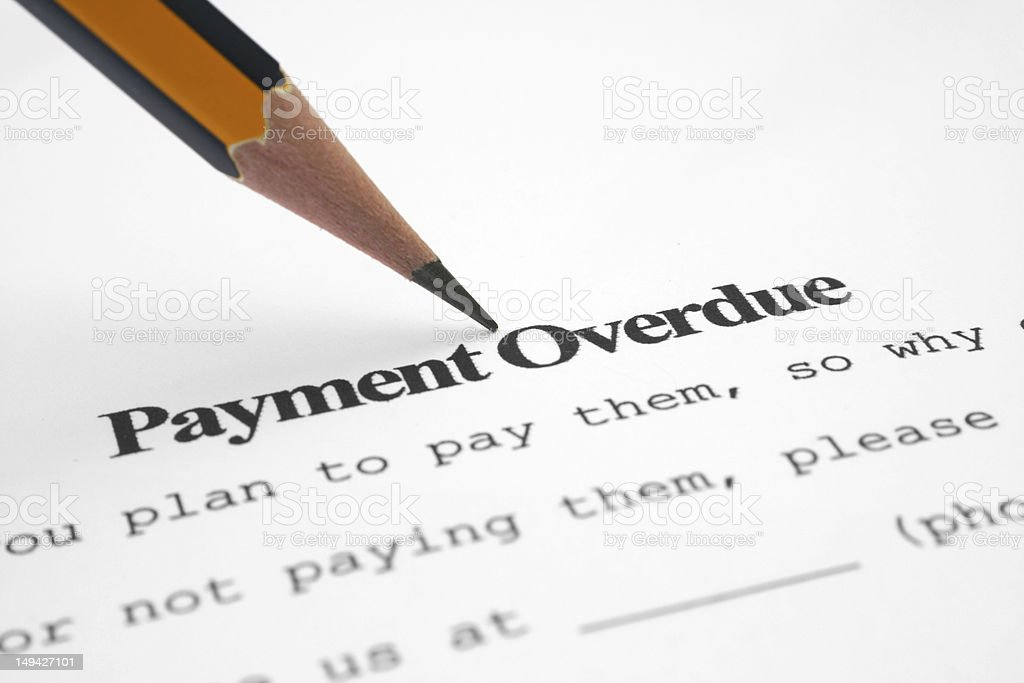 Pencil pointing at text 'payment overdue' royalty-free stock photo