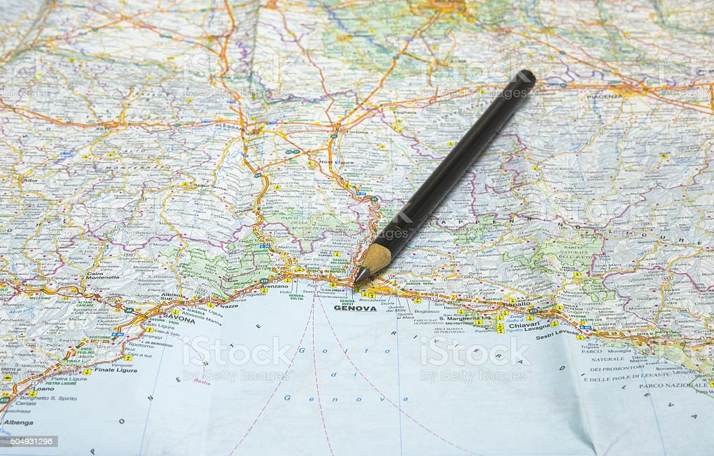 Pencil points at Genova on a map of Italy stock photo