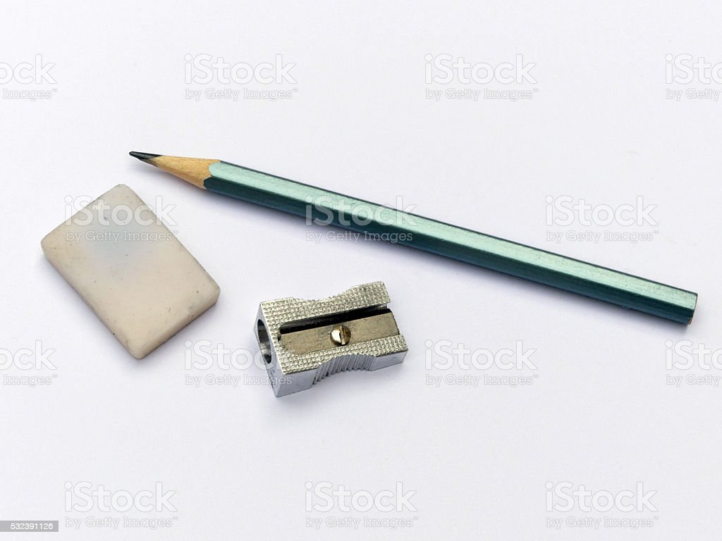 Pencil, sharpener and eraser stock photo