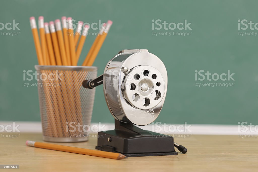Pencil sharpener and pencils stock photo