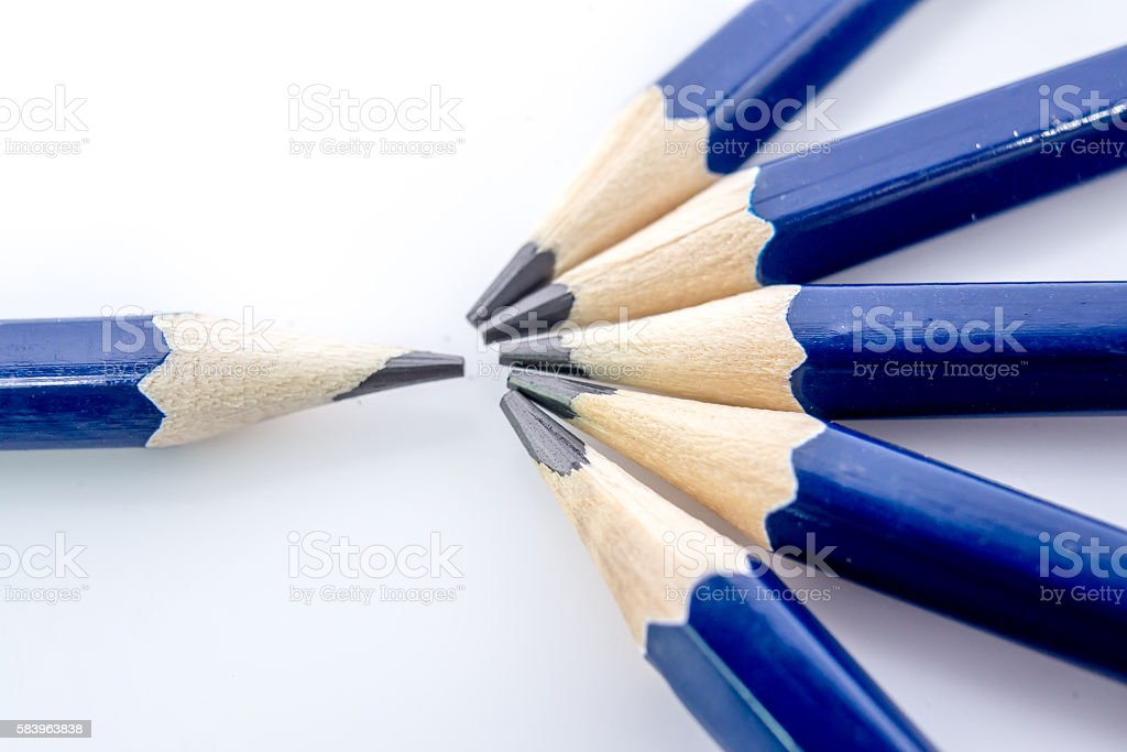 Pencil sharpener shavings and several bars on a white background. stock photo