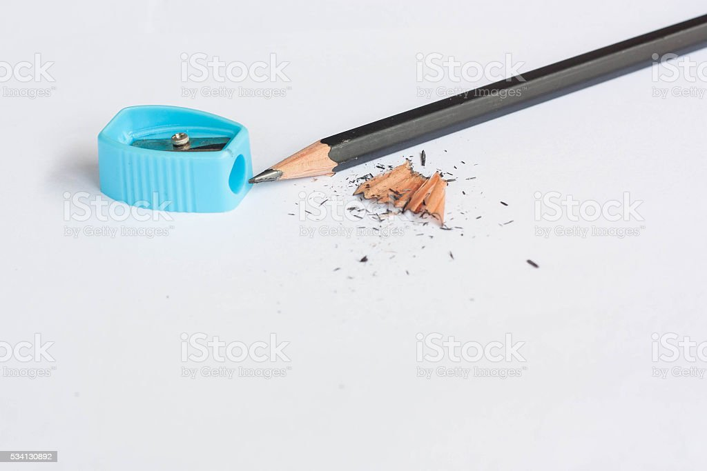 Pencil sharpener with black pencil on white background. stock photo