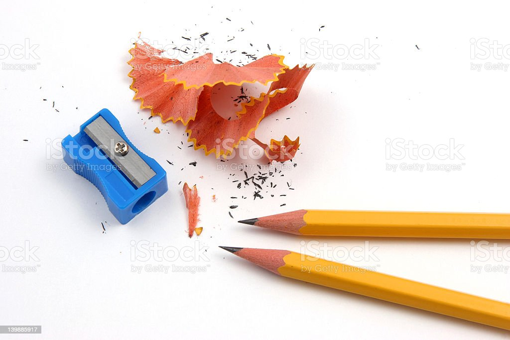 Pencil sharpening pair stock photo