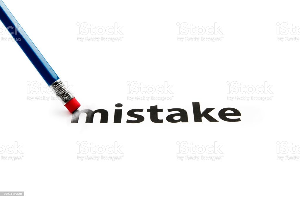 A pencil with eraser is correcting mistake. Eraser and mistake concept. To erase mistake. stock photo