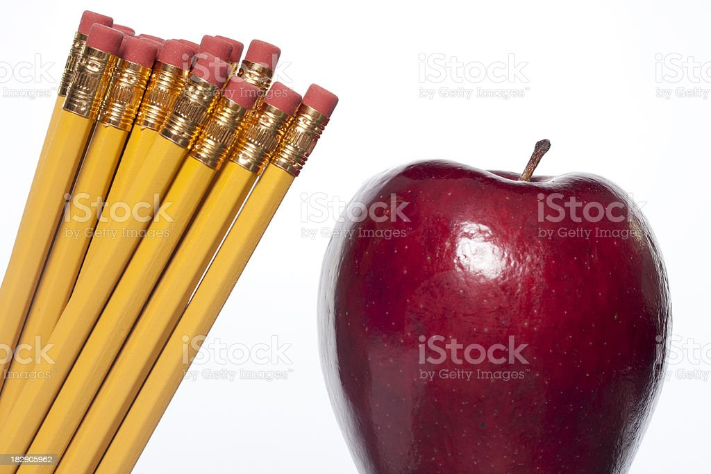 Pencils and Apple stock photo