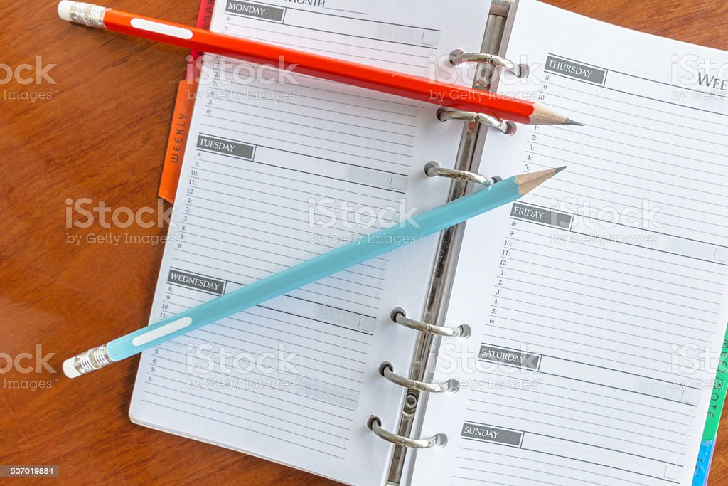Pencils and Blank notepad stock photo