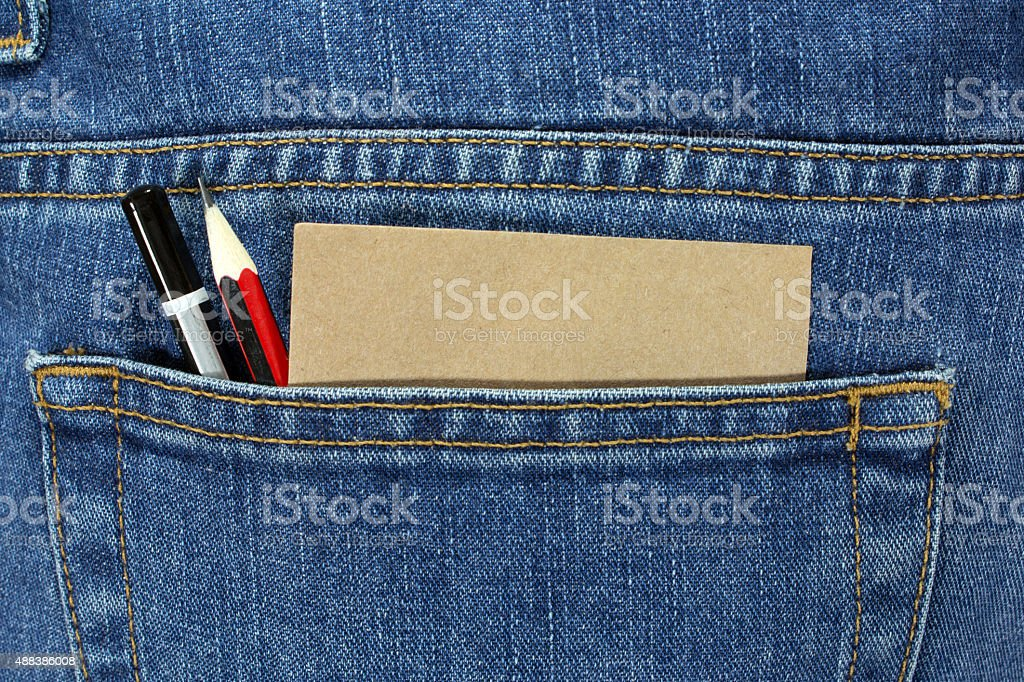 Pencils and note paper in denim pocket stock photo