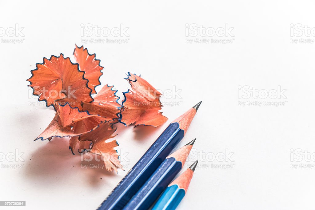 Pencils and sawdust pencil put on white paper stock photo