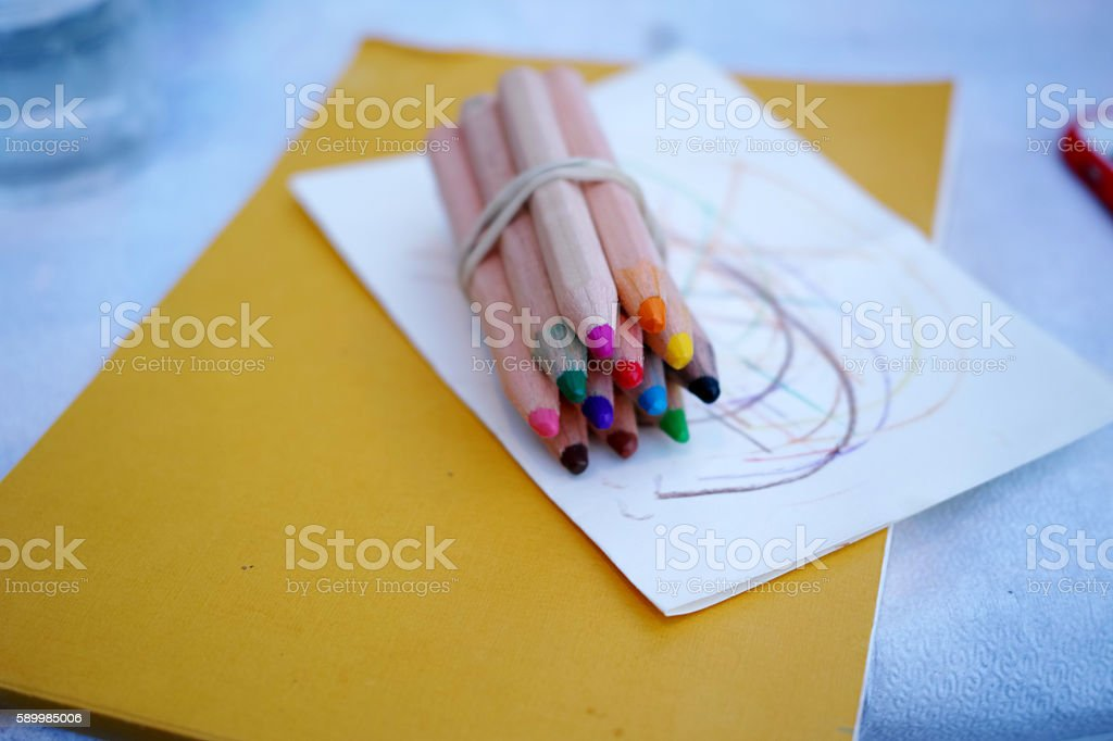 Pencils Are Vibrant All Together On The Yellow Paper stock photo