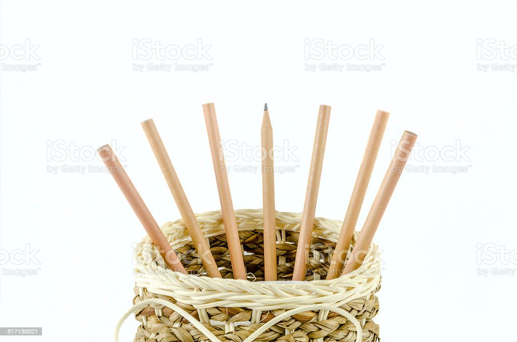 Pencils in a basket on isolated background stock photo