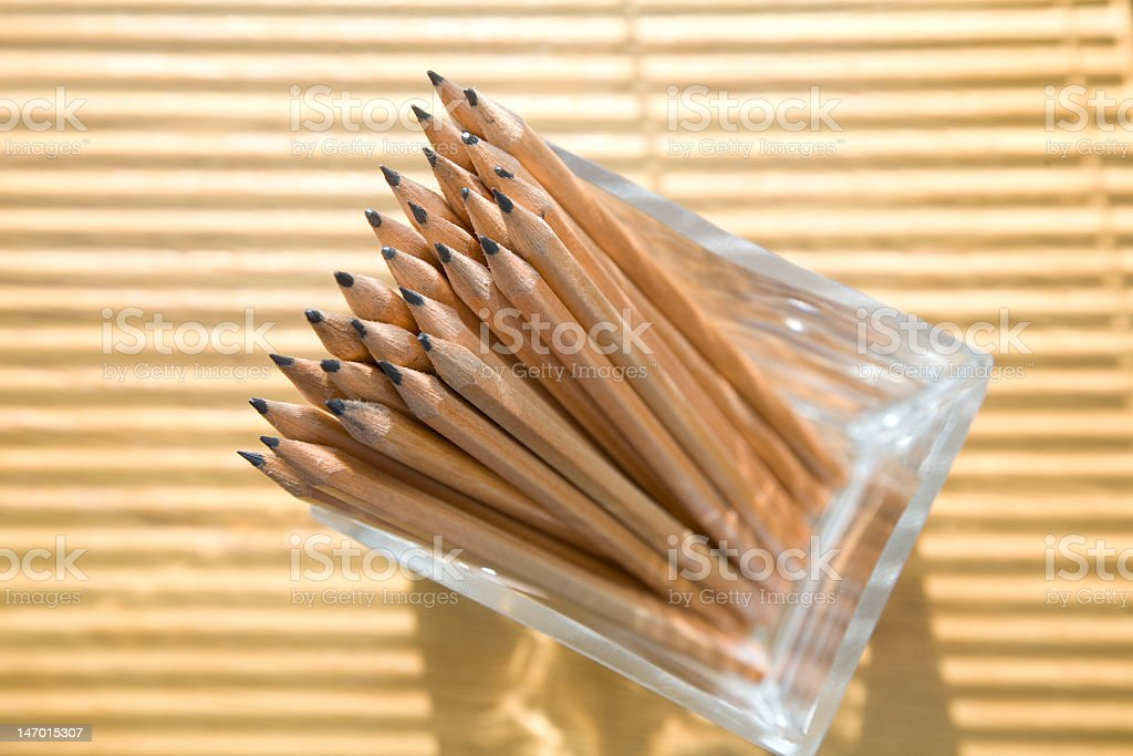Pencils in a glass at the office royalty-free stock photo