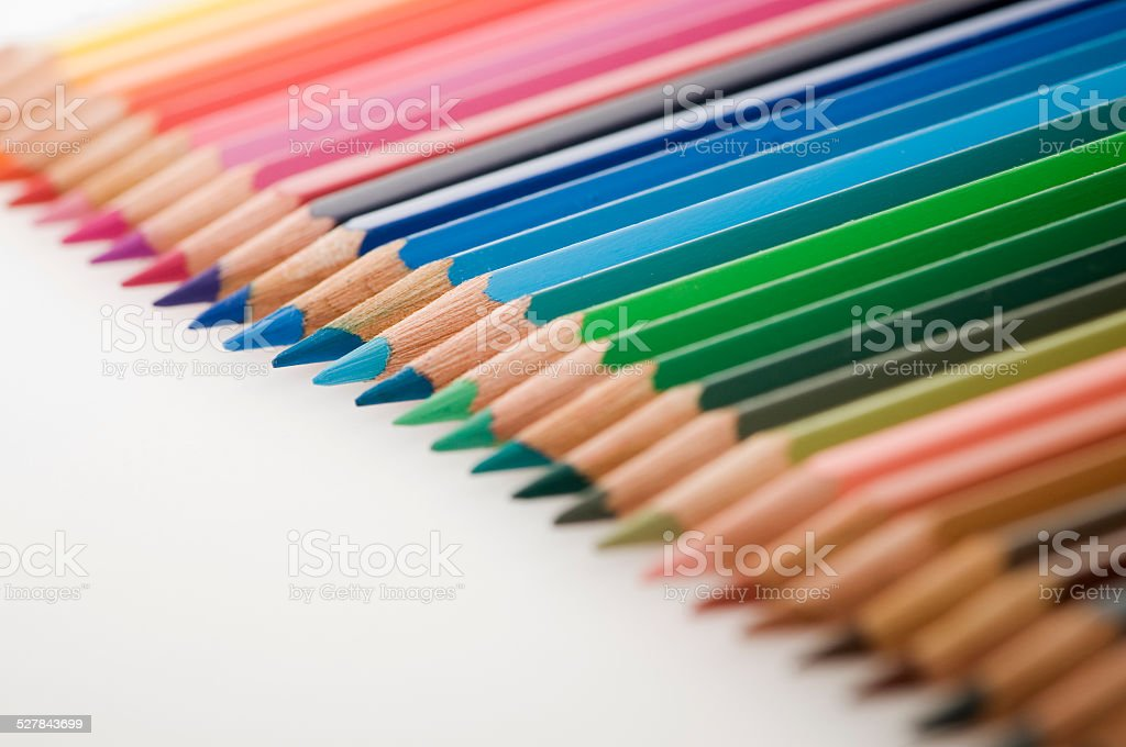pencils in a row focus on blue stock photo