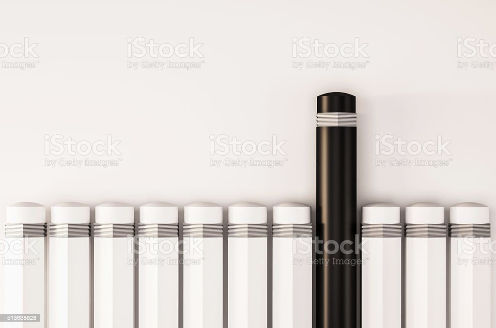 Pencils in a row with unique one standout from others stock photo