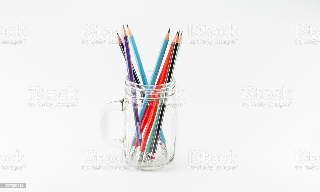 Pencils in glass jar stock photo