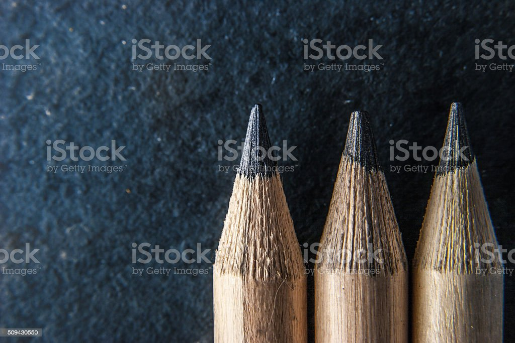 Pencils on the dark stone  background  close-up stock photo