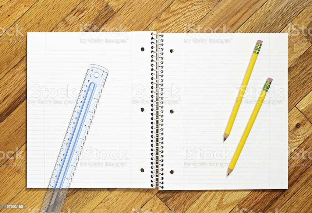 Pencils, ruler and blank notebook stock photo
