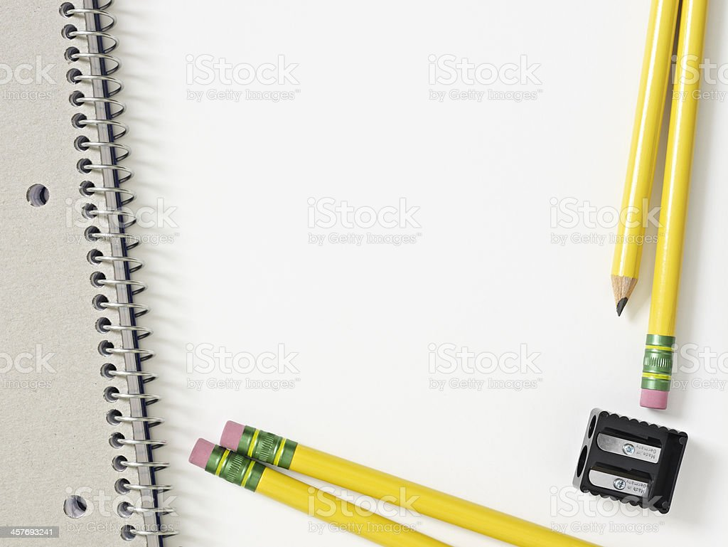 Pencils, sharpener and notebook stock photo