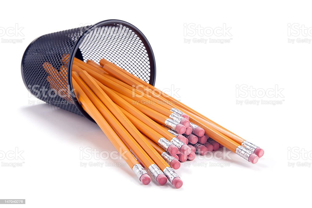 Pencils Spilling From Cup stock photo