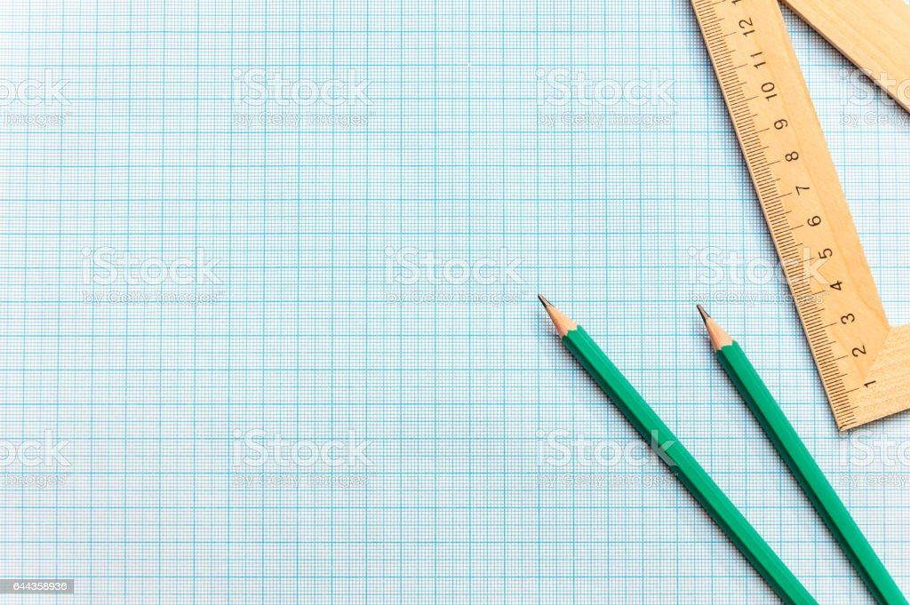 Pencils with ruller on the graph paper. stock photo