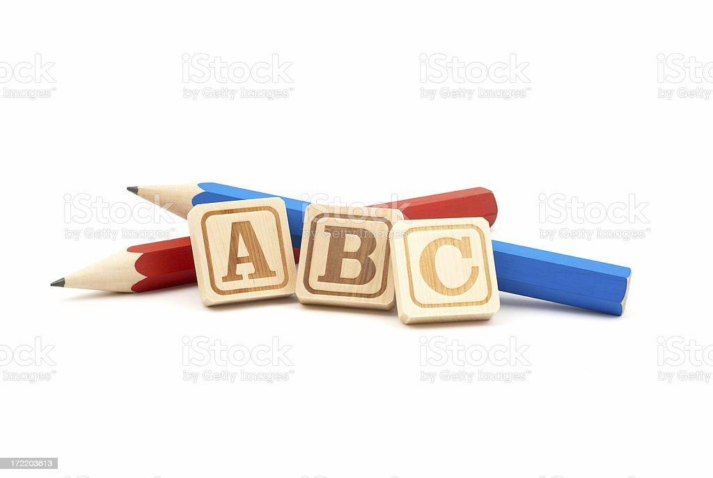 Pencils with Wooden Alphabet Blocks stock photo