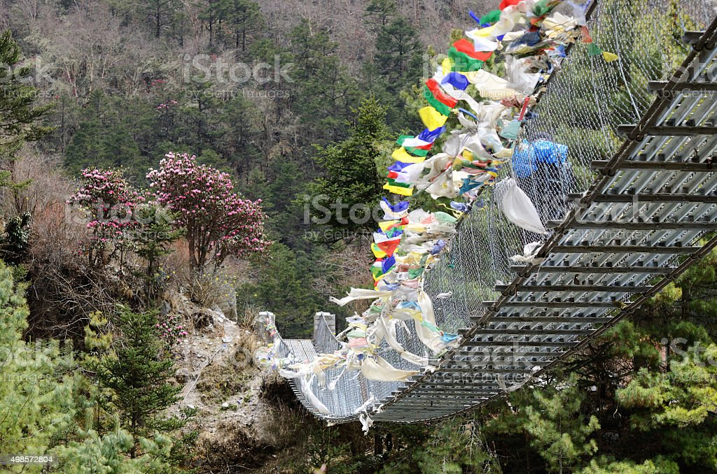 Pendant bridge connecting banks of river Dudh Kosi, eastern Nepal stock photo