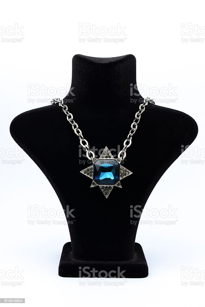Pendant star  with blue stones on mannequin isolated on white stock photo
