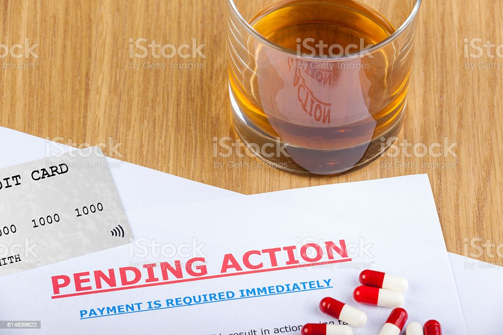 Pending action letter with credit card and pills stock photo