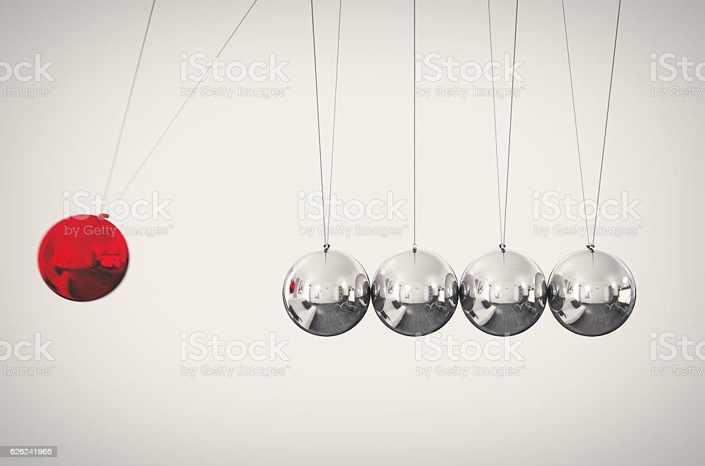 Pendulum Action Reaction stock photo