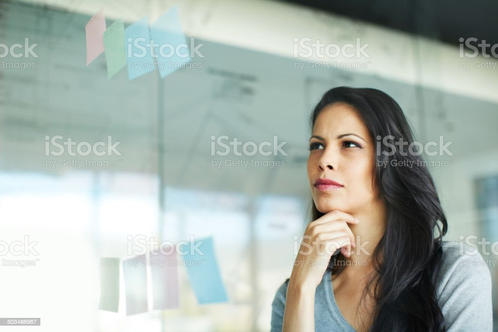 Penetrating the problem with her steely gaze stock photo