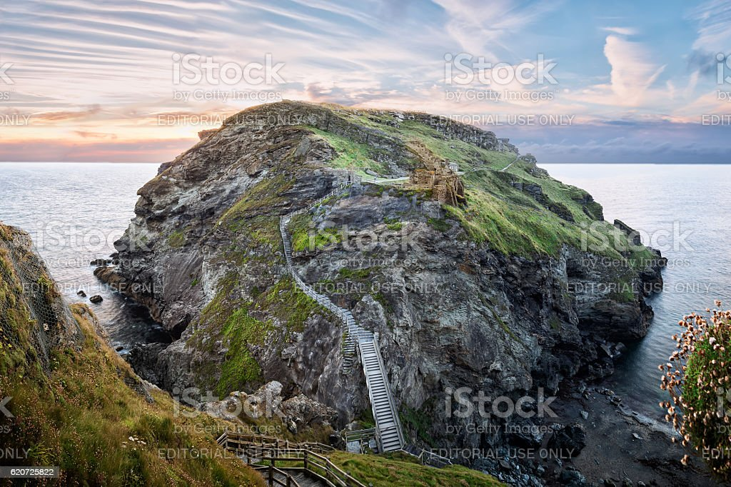 Peninsula of Tintagel Island and legendary castle ruins at sunset stock photo