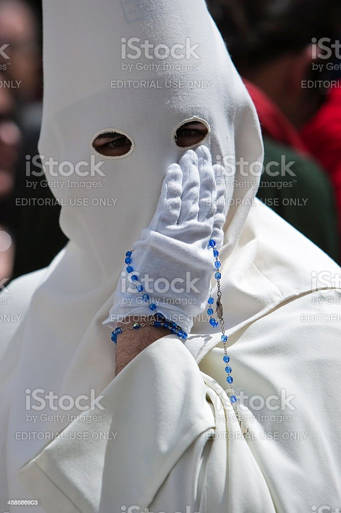 Penitent with a rosary in his hand royalty-free stock photo