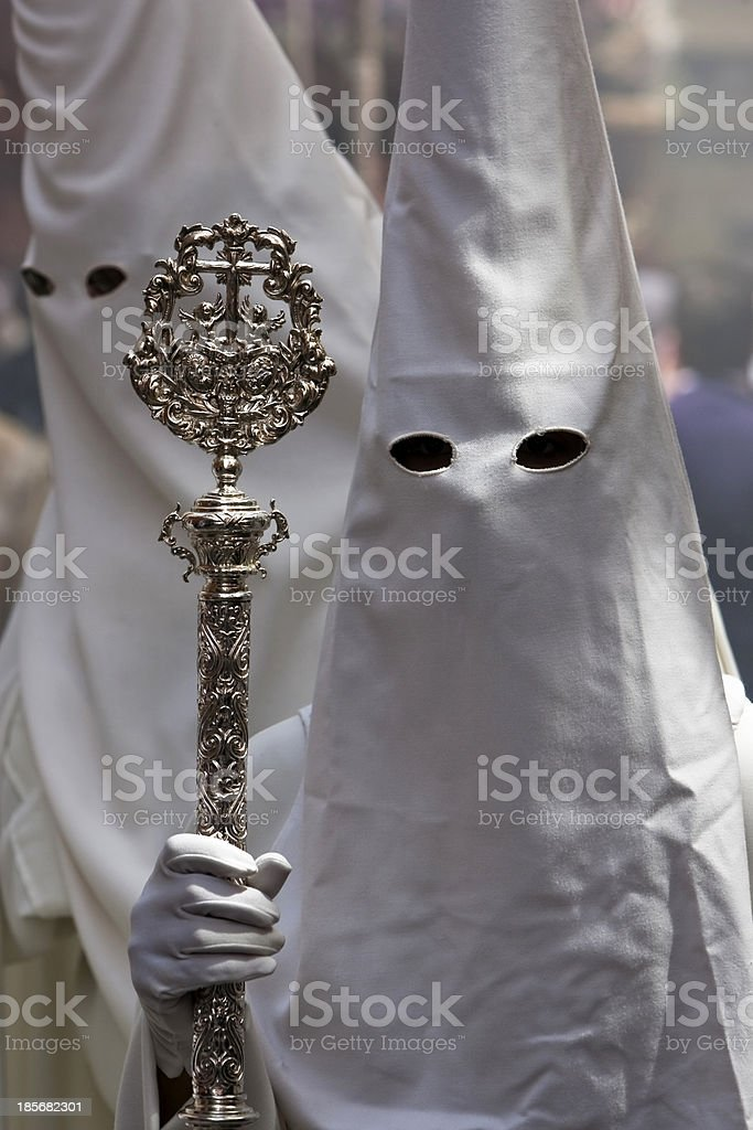 Penitent with staff of silver during holy week stock photo