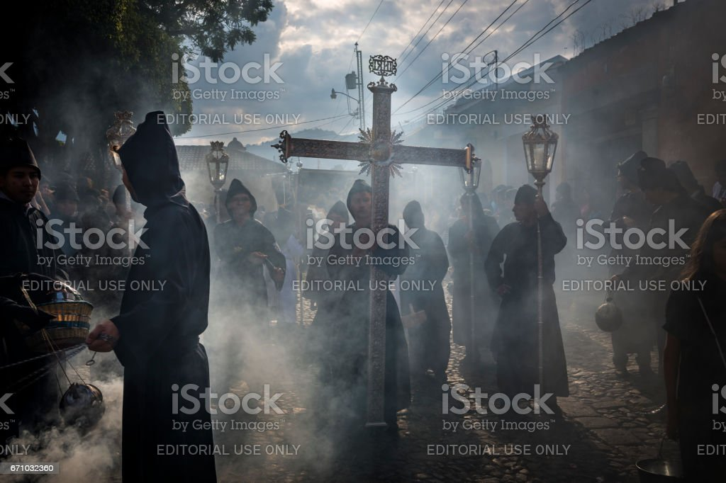 Penitents in an Easter procession during the Holy Week in Antigua, Guatemala stock photo