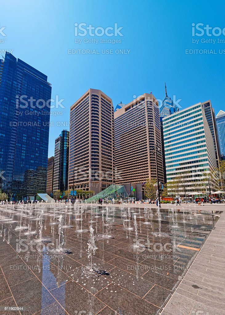 Penn Square with street fountains and skyline of skyscrapers stock photo
