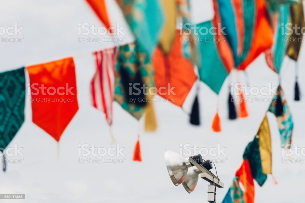 Pennants and garlands of colors with metal lamppost stock photo