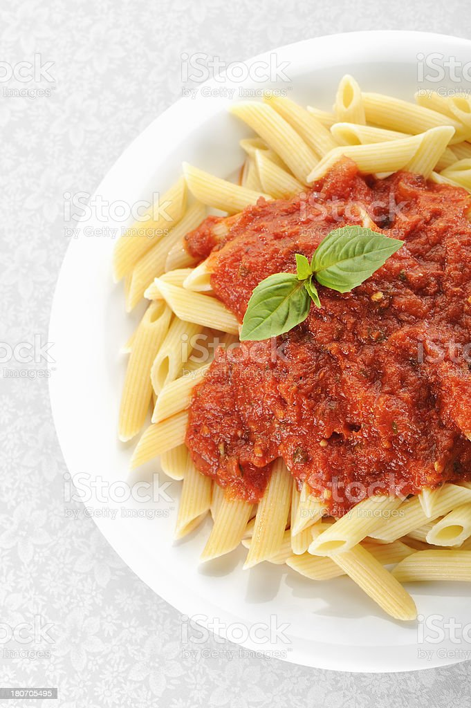 Penne and tomato sauce stock photo