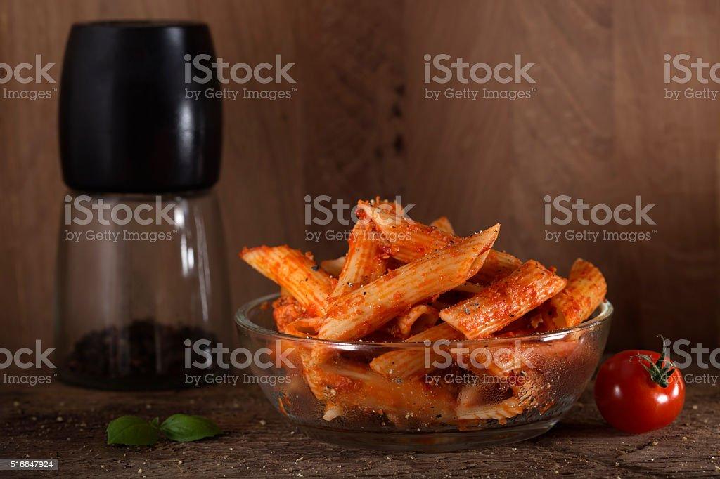Penne pasta in tomato sauce stock photo