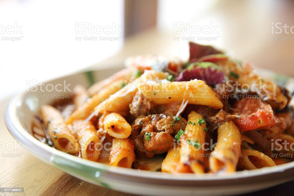 Penne pasta in tomato sauce with meatballs stock photo