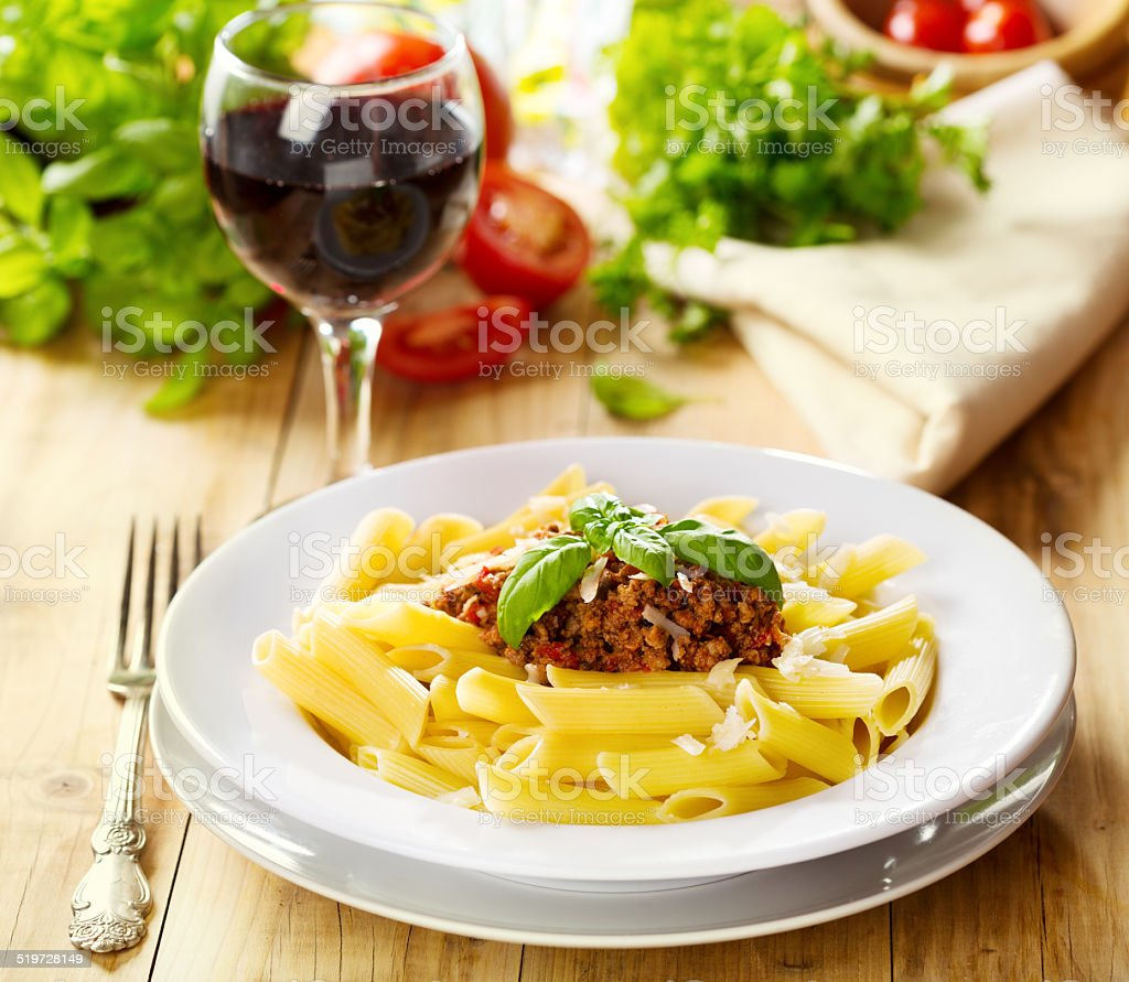 penne pasta with bolognese sauce stock photo