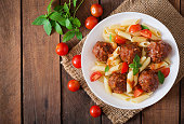 Penne pasta with meatballs in tomato sauce