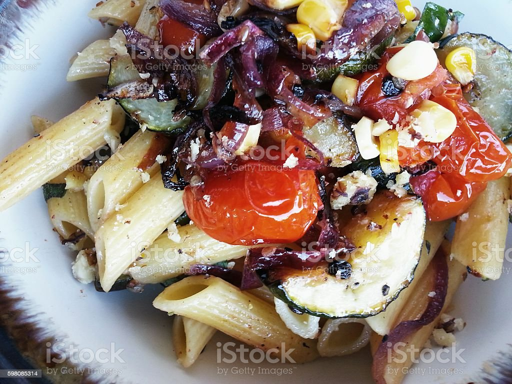 Penne Pasta with Roasted Zucchini, Cherry Tomatoes stock photo