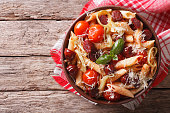 penne pasta with sausage, leeks, cheese and tomato. Horizontal