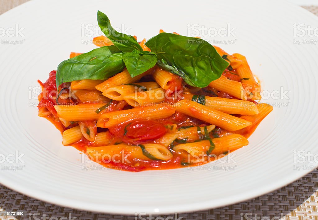 Penne Pomodoro, short pasta with tomato sauce on a plate stock photo