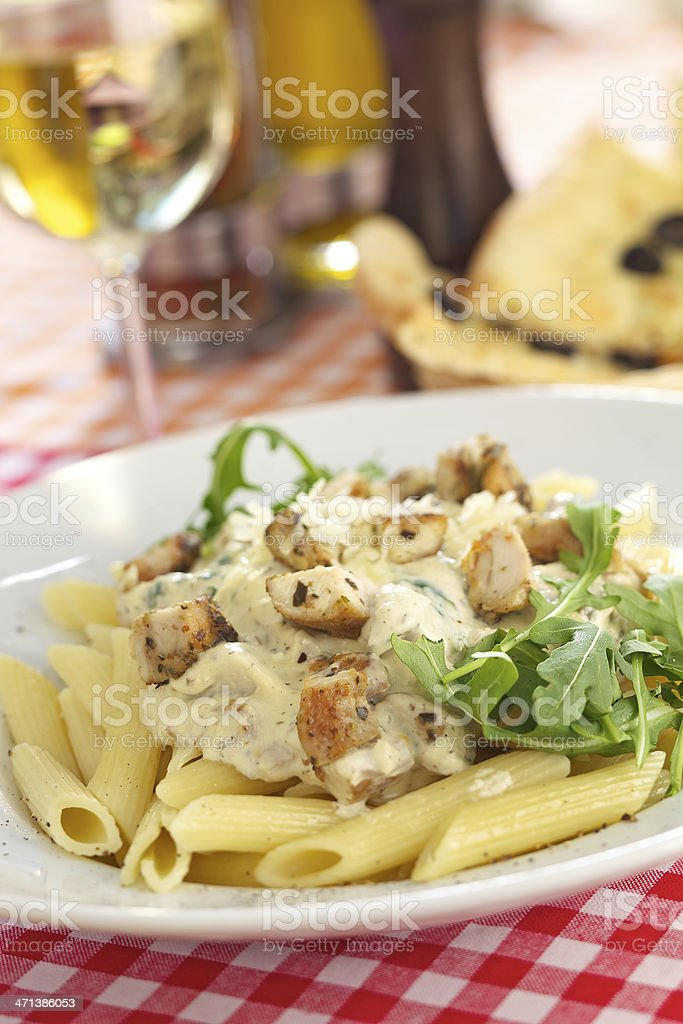Penne with chicken and gorgonzola stock photo