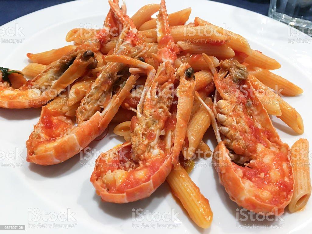 Penne with jumbo shrimps stock photo