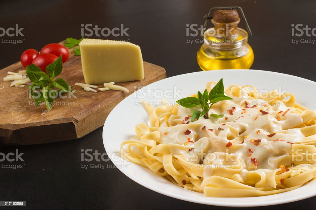 Penne with milk cream stock photo